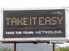 "Advertising billboard, ""Take It Easy. Take The Train. Metrolink"" - Click for larger image (http://jamesmcgillis.com)"