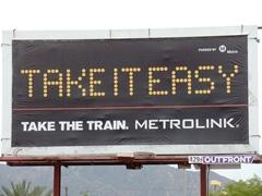 "Advertising billboard, ""Take It Easy. Take The Train. Metrolink"" - Click for larger image (https://jamesmcgillis.com)"