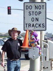 The author, James McGillis, with safety advocates Coney the Traffic Cone and Plush Kokopelli at the infamous Fifth & Rice Grade Crossing in Oxnard, CA - Click fro larger image (http://jamesmcgillis.com)