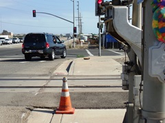 Battered, but not beaten, Caltrans Coney stands guard at the Fifth and Rice railroad grade crossing, hoping to prevent motorists from turning on to the railroad tracks at that derelict and confusing intersection - Click for larger image (https://jamesmcgillis.com)