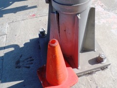 Coney the Traffic Cone sits next to the damaged base of the crossbuck sign at Fifth and Rice railroad grade crossing in Oxnard, California - Click for larger image (http://jamesmcgillis.com)