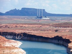 The lower reaches of Lake Powell (foreground) and the infamous, coal-fired Navajo Generating Station in the background, belching nitrogen oxide in 2015 - Click for larger image (http://jamesmcgillis.com)