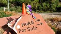 Plush Kokopelli and Coney the Traffic Cone lament that even natural areas near Moab are up for sale - Click for larger image (http://jamesmcgillis.com)