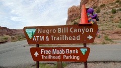 In 2015, Plush Kokopelli and Coney the Traffic Cone tested a new Moab Bank ATM at Negro Bill Trailhead, near Moab, Utah - Click for larger image (http://jamesmcgillis.com)