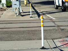 Only two reflective safety pylons have been installed where Mr. Jose Sanchez-Ramirez made his errant and deadly wring turn on to the railroad tracks - Click for larger image (http://jamesmcgillis.com)