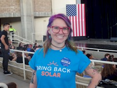 "A former SolarCity employee in her ""Bring Back Solar"" t-shirt at a Bernie Sanders campaign rally in Henderson, Nevada in February 2016 - Click for larger image (http://jamesmcgillis.com)"