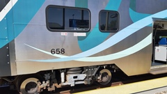 Featuring outboard disk brakes and stainless steel sheathing, Hyundai-Rotem coaches and cabcars began service on Metrolink in 2010 - Click for larger image (http://jamesmcgillis.com)