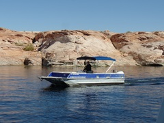 With this 26-ft. outboard, we explored the side canyons of Lake Powell - Click for larger image (http://jamesmcgillis.com)