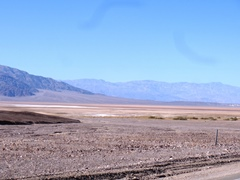 Looking from Furnace Creek toward Stovepipe Wells in November 2016, the roadside was ravaged by flooding, but the Death Valley salt flats were dry - Click for larger image (http://jamesmcgillis.com)