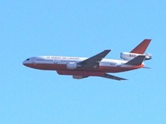 This DC-10 tanker aircraft can deliver 12,000 gallons of fire retardant on each pass over the flames - Click for larger image (http://jamesmcgillis.com)