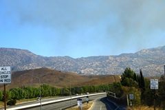 Smoke rises over the closed Highway 118 in Simi Valley as hills near the Santa Susana Field Laboratory during the Peak Fire, November 11, 2018 - Click for larger image (http://jamesmcgillis.com)