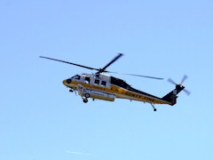 A Los Angeles County Firehawk helicopter descends for a water pickup in Simi Valley, California - Click for larger image (http://jamesmcgillis.com)