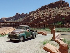 "Jim Farrell's 1950 Chevy ""Moab Truck"" rests atop the original 1912 highway bridge abutment along the Colorado River at Moab, Utah, with the Riverway Bridge in the background - Click for larger image (http://jamesmcgillis.com)"