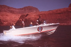 A Bertram 20 powerboat planes past our boat on the way to Rainbow Bridge, Lake Powell, Utah in 1965 - Click for larger image (http://jamesmcgillis.com)