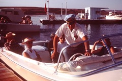 Author Jim McGillis visible under the skipper's arm, prior to departure from Wahweap Marina, Lake Powell in 1965 - Click for larger image (http://jamesmcgillis.com)