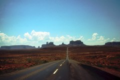 1965 view of U.S. Highway 163 South, heading toward Monument Valley, Utah. It is the place where Forest Gump stopped running. Click for larger image (http://jamesmcgillis.com)