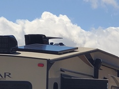 The 200-watt solar panel attached to the roof om my RV produces adequate electrical power for off-grid camping - Click for larger image (https://jamesmcgillis.com)