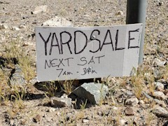 A small sign advertised a possible yard sale in the middle of the Mojave Desert - Click for larger image (http://jamesmcgillis.com)