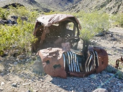 Prior to abandonment in the depths of a canyon in the Argus Range, Death Valley National Park, someone had welded a replacement grill on to this 1937 Chevy sedan - Click for larger image (http://jamesmcgillis.com)
