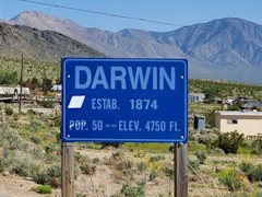 The official sign at Darwin, California includes its establishment in 1874 and its population, that ranges around fifty souls - Click for larger image (http://jamesmcgillis.com)