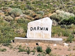 Looking much like a tombstone, This handmade sign shows the way to Darwin, California - Click for larger image (http://jamesmcgillis.com)