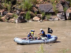 Much like Edward Abbey and Ralph Newcomb did in 1959, this family enjoys rafting the spring flood of the Colorado River near Moab, Utah in 2006 - Click for larger image (http://jamesmcgillis.com)