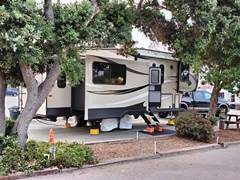Our Cougar fifth wheel in a shaded spot at the Morro Dunes RV Park, in Morro Bay, California - Click for larger image (http://jamesmcgillis.com)