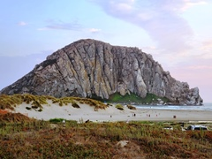Morro Rock, chipped away and hauled away to make breakwaters up and down California still stands as the largest monolith on the California coast - Click for larger image (http://jamesmcgillis.com)