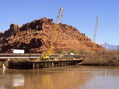 In 2009, the first of two new highway bridge-spans across the Colorado River at Moab was then under construction - Click for larger image (http://jamesmcgillis.com)