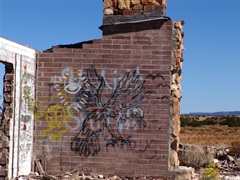 In 2011, a Golden Eagle with wings spread and talons showing is only partially obscured by random graffiti - Click for 2012 image of destruction - (http://jamesmcgillis.com)