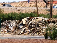 When they tore it down, owners of the old Oasis Resort Casino in Mesquite, Nevada attempted to recycle as much of the building materials as possible - Click for larger image (http://jamesmcgillis.com)