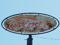 The old hand-painted Ford Sign tops the tower at Harley's Garage, Mesquite, Nevada - Click for larger image (http://jamesmcgillis.com)