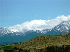 Clouds surmount the snowy slopes of the San Gabriel Mountains near Wrightwood, California, as seen from Pearblossom Highway, CA-138E - Click for larger image (http://jamesmcgillis.com)
