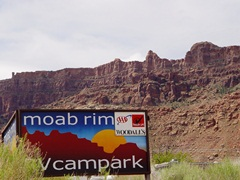 Moab RV Campark sign, with the Moab Rim in the background - Click for larger image (http://jamesmcgillis.com)