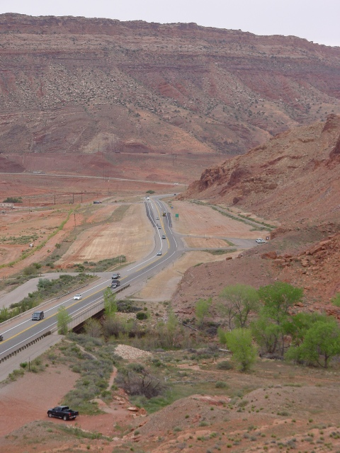 U.S. Highway 191 North of Moab, Utah. In the foreground, the highway crosses Courthouse Wash. In the middle ground is the UMTRA, Moab nuclear clean-up site. In the background is the northern reach of the Moab Rim near the Arches National Park entrance (http://jamesmcgillis.com)