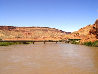 Near flood stage, the Colorado River Highway Bridge, Moab, Utah (http://jamesmcgillis.com)