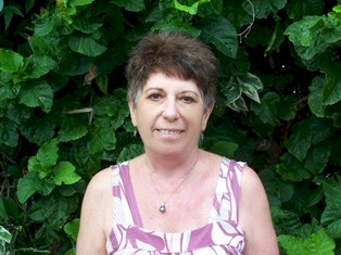 2008 Photograph of the late Joan Moody (1937-2010), at her home, Moody's Namena Resort, in the Fiji Islands - Click for larger image (http://jamesmcgillis.com)