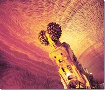 Looking like a Native American Kachina, an underground excavator in Australia creates dry potash salt tailings in - Click for larger image (http://jamesmcgillis.com)