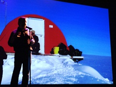 Author Craig Childs stands before his own projected image, at the doomed camp on the Greenland Ice Shield - Click for larger image (http://jamesmcgillis.com)