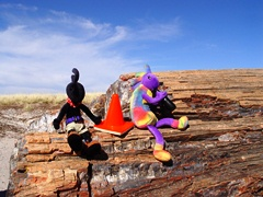 Un-retouched photo of Kokopelli, Coney (the traffic cone) and Kokopelli atop a petrified log in the Petrified Forest National Park - Click for larger image (http://jjamesmcgillis.com)