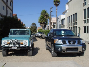 "Two classic 4X4s, with ""stuck truck"" in the background at Venice Beach - Click for larger Image (http://jamesmcgillis.com)"