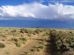 On the road to Kin Klizhin Ruins, looking northeast at a receding thunderstorm - Click for larger image (http://jamesmcgillis.com)