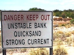 As the dry season approaches, a warning sign tells of an unstable bank, quicksand and strong currents possible along the Little Colorado River at Homolovi Ruins State Park, Arizona - Click for larger image (http://jamesmcgillis.com)