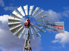 A new FIASA brand, Argentine made windmill gleams in the New Mexico sun, near Kin Klizhin, Chaco Canyon, NM - Click for larger image (https://jamesmcgillis.com)