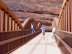Tourists enjoy the Colorado River Bicycle Bridge at Moab, Utah - Click for larger image (http://jamesmcgillis.com)