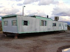 Older mobile homes, like this one in Moab, Utah were not built for high winds or current energy efficiency standards - Click for larger image (http://jamesmcgillis.com)