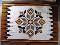 Navajo Indian rug, with a corn-motif border, typical of many Little Colorado River Basin rugs - Click for larger image (http://jamesmcgillis.com