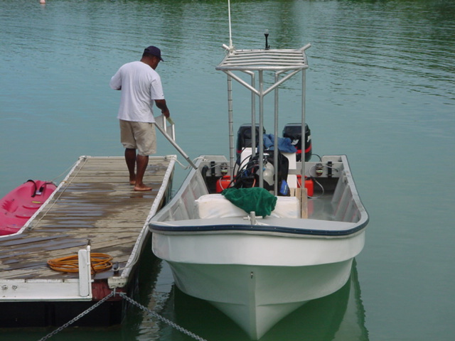 Sam, the Dive Master, loading the Cousteau dive boat, Vanua Levu, Fiji in August 2001 - Click for larger image (http://jamesmcgillis.com)