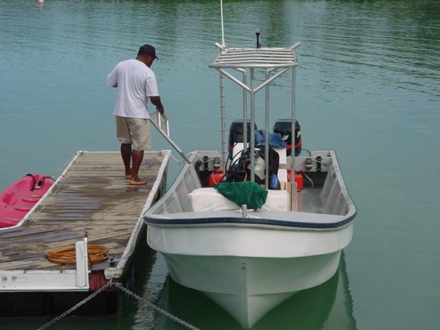 Sam, the Dive Master, loading the Cousteau dive boat, Vanua Levu, Fiji in August 2001 - Click for larger image (https://jamesmcgillis.com)