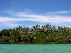 From one quarter mile offshore on Natewa Bay, Vanua Levu, Fiji, the Lomalagi Resort is hard to see among the lush greenery of the island - Click for larger image (http://jamesmcgillis.com)